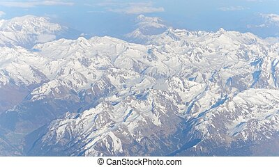 The Alps snowy mountain peaks on a sunny day, aeial view -...