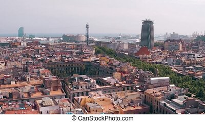 Barcelona rooftops and distant seaport, Spain. 4K pan shot -...