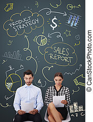 White collar workers doing sales report