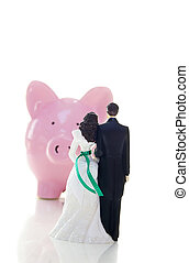 cake-topper wedding couple and piggy bank money troubles...