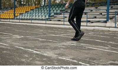 Runner Comes for Low Start - Runner's low start at the...