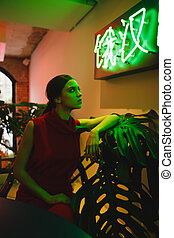 Vertical image of woman in eatery - Vertical image of woman...
