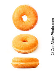 Three donuts in different positions - A picture of three...