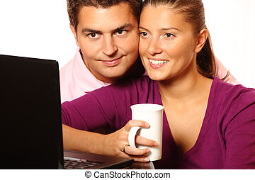 Young married couple browsing the Internet - A picture of a...