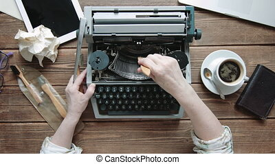 Writer with retro writing machine. - Writer cleans retro...