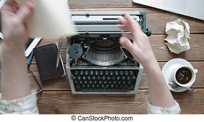Writer with retro writing machine. - Writer refill paper in...