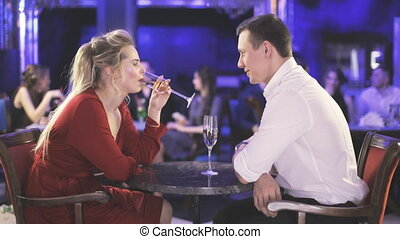 Woman and man with wine in restaurant