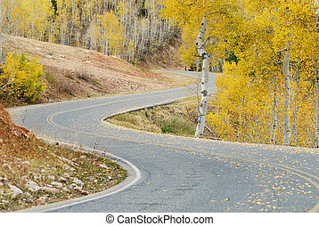 Mountain Road - Mountain road with curves during autumn with...