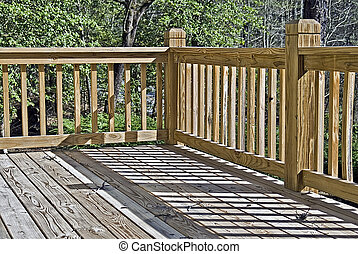 Corner of a wood deck - Corner shot of a wooden deck in...