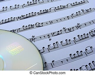 Sheet music & cd - A sheet of music notes with a cd-rom in...