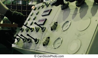 Worker's hands on the machine control panel - Close up of...