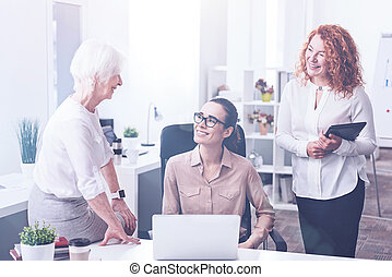 Three female workers being in the office - Good day. Elderly...