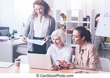 Delighted pretty women looking at the laptop - Be confident....