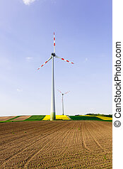Wind farm with spinning wind turbines
