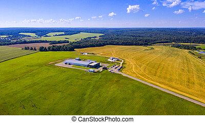 Aerial view on modern farm buildings