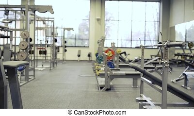 Gym with various exercise machines in it - Modern gym with...