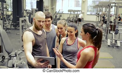 Young people in crossfit gym, taking selfie with tablet. -...