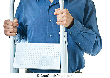 Mid-section of man in dress shirt holding step ladder - The...