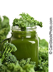 green smoothie - a green smoothie served in a glass mason...