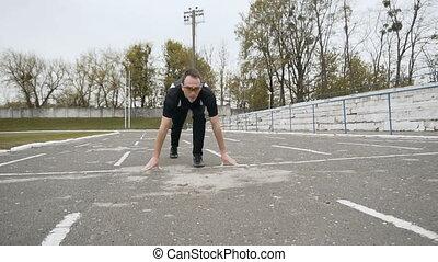 Runner Low Start - Runner's low start at the stadium, fast...