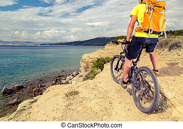 Mountain biker looking at view and riding a bike