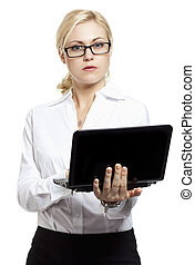 A young serious business woman using laptop on white
