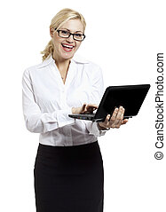 A happy young business woman using laptop on white