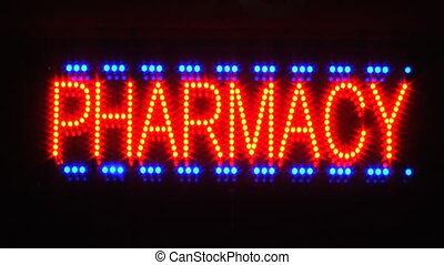 Pharmacy sign. - Pharmacy sign outside a drugstore at night....