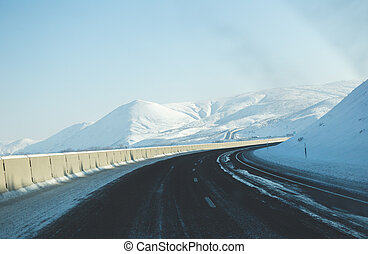 Winter Highway Curve - Two-lane highway curving around...