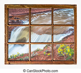 waterfall with wildflowers window view