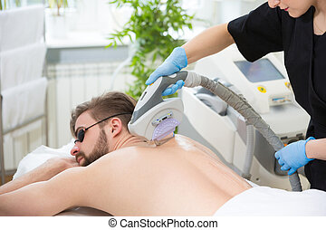 IPL therapy at men's back - Permanent hair removal at...