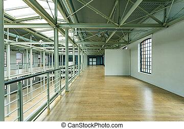 Wooden floor in factory - Wooden floor and white walls in...