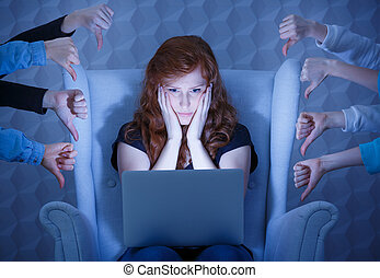 Negative comments on website - Worried young woman having...