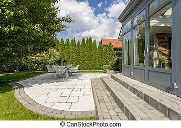 House exterior with terrace and trees