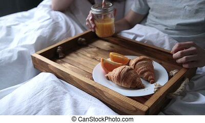 Young couple enjoying romantic breakfast in bed - Attractive...