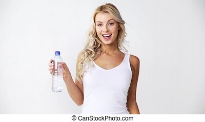 happy beautiful young woman with bottle of water - healthy...