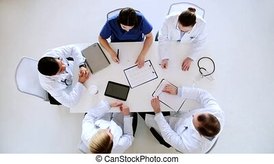group of doctors with cardiogram at hospital - medicine,...