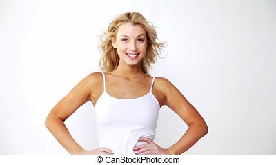 happy smiling beautiful young woman in white top