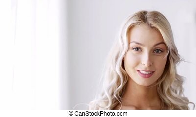 face of smiling beautiful young woman