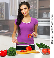 Cooking woman in the kitchen