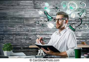 Education concept - Handsome young man at workplace holding...