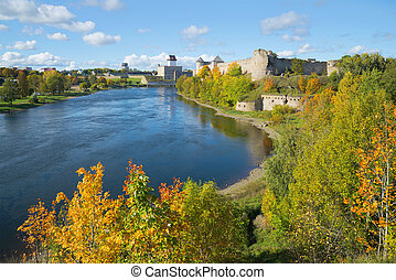 Golden Autumn on the border river Narva. View of the Russian...