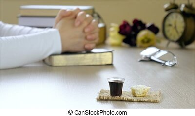 Woman praying before taking communion. The blood and the...