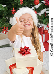 Extremely happy litte girl with christmas present -...