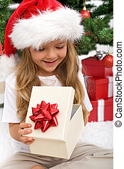 Little girl opening christmas present - Little girl opening...
