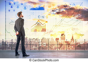 Accounting concept - Side view of young man on rooftop...