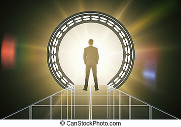 Man in front of amber teleport - Back view of businessman...