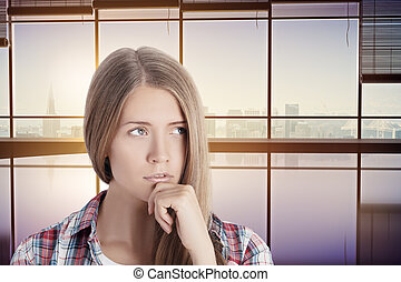 Thoughtful woman in interior with city view - Portrait of...