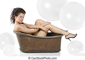 old fashion bathtub - young naked woman with pearl on face...