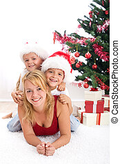 Happy people in front of christmas tree